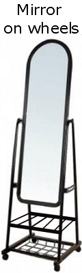 A light weight mirror on rolling stands that is adjustible and transportable. Useful for boutiques, fashion designers and dancers.